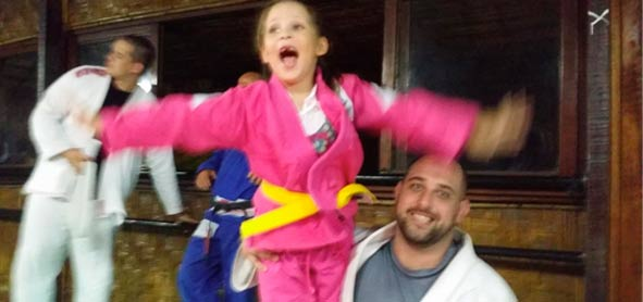 Kayla gets a surprise visit from daddy Victor at her yellow belt promotion.
