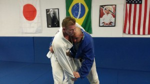 David establishes the clinch with a right arm underhook and sleeve control.