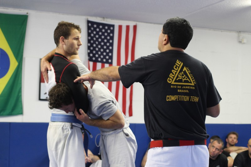 Rolker working with Stephen and Jeff on guillotine technique.